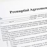 person signing a prenuptial agreement